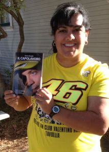 Holding Rossi's book, which he autographed for me