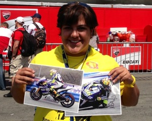 Holding the photos that Rossi autographed for me