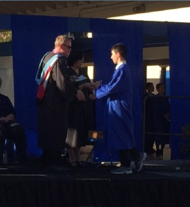 Receiving his promotion certificate from School Vice Principal, Erik Taylor